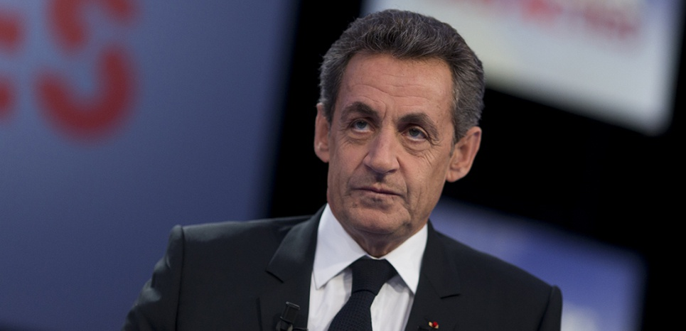 "Former French president and head of Les Républicains main opposition party, Nicolas Sarkozy poses prior to take part in the political talk show ""Des paroles et des actes"" of French TV channel France 2 on February 4, 2016 in Paris.  / AFP / KENZO TRIBOUILLARD"