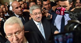 Newly appointed Algerian Prime Minister Ahmed Ouyahia (C) arrives for a congress session in the capital Algiers on September 4, 2017.  / AFP PHOTO / RYAD KRAMDI / RYAD KRAMDI        (Photo credit should read RYAD KRAMDI/AFP/Getty Images)
