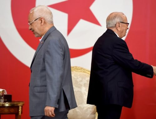 Tunisian President Beji Caid Essebsi (R) and Tunisian leader of Islamist Ennahdha party Rached Ghannouchi attend a ceremony for the signing of documents outlining the roadmap for the formation of a national unity government in Tunisia at the Carthage Palace in Carthage, some 15 kilometres on the outskirts of Tunis, on July 13, 2016. The pact summarizes the priorities of the country's future government including; combating terrorism and corruption, boosting development and youth employment, achieving administrative reform and implementing the policy of the city and local authorities.  / AFP / FETHI BELAID        (Photo credit should read FETHI BELAID/AFP/Getty Images)