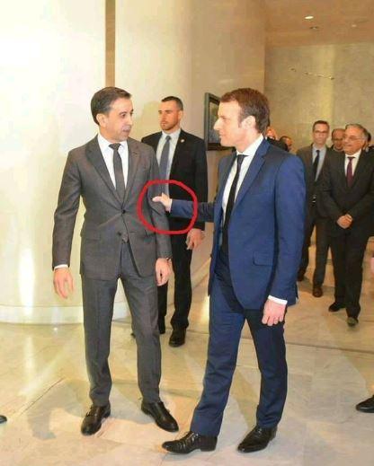 DIA-Macron-serre-le-bras-de-Haddad.jpg